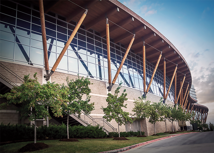 """An exterior photograph of the 2007 Branson, Missouri, Convention Center, a great example of modern hybrid """"heavy timber"""" buildings."""
