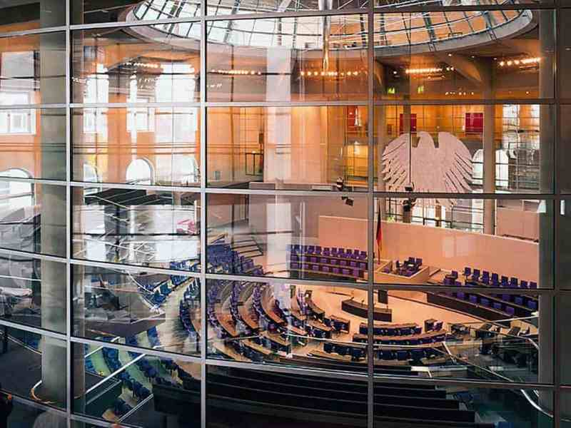 "Pilkington Pyrodur® specially designed EW 30 glass solution in a 16 m high partition system reliably protecting the plenary hall of the German Parliament ""Reichstag"" in Berlin."