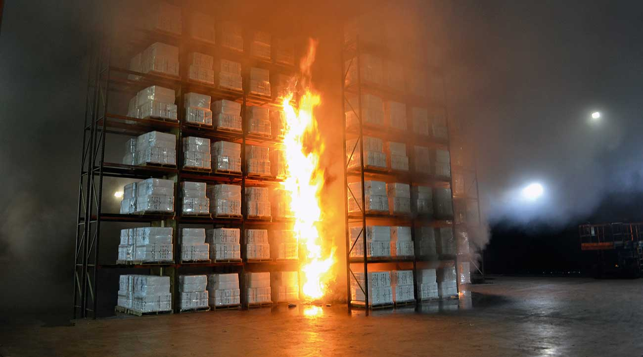 Photo of a fire test taken shortly after sprinkler operation.