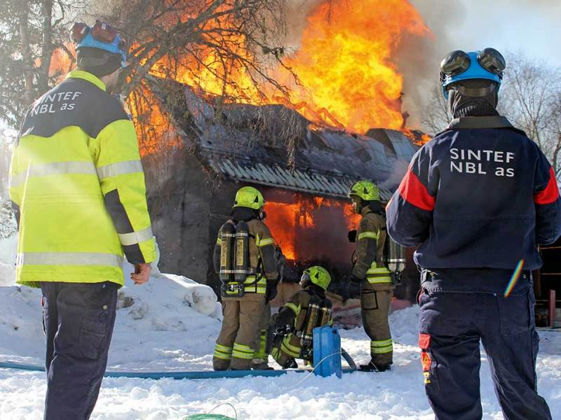 Most fires take place in the victim's home. Here; Norwegian fire fighters on training, while researchers from SP Fire Research (former SINTEF NBL) perform measurements as part of a research project.