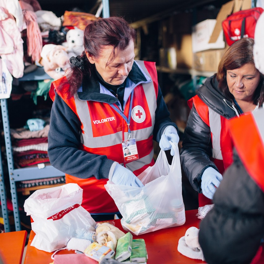 Slavonski Brod transit camp in Croatia. Croatian Red Cross volunteers sort donated clothes which are then given to refugees.