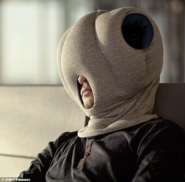 ostrich pillow mini allows tired tourists to snooze on a plane and against a wall travelling blogger