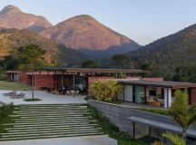 Terracotta-tinged walls match the surrounding mountains in ...