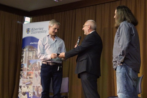 Ed Fries is given a Sgian Dubh as a token of thanks from Abertay University's Louis Natanson and IGDA Scotland's Luke Dicken