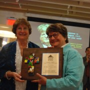 Loretta Holstein and Sr. Helen Prejean with the Robert M. Holstein Award plaque