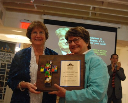 Loretta Holstein and Sr. Helen Prejean with the Robert M. Holstein Award plaque