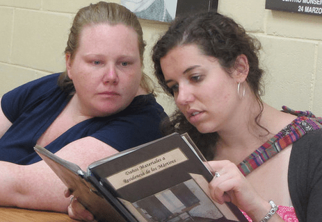 Katie Hart (right) with Amy Chapman at the Romero Center on the UCA campus during ISN's 25th anniversary delegation to El Salvador in July 2014.