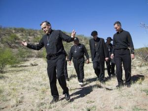 Bishop Elizondo leading other bishops and Jesuit Father Sean Carroll during a tour of Catholic facilities serving migrants in 2014. [SOURCE: USCCB]