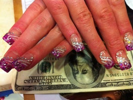 Jane Tran Of Nail Art And Spa In Elgin Applies The Veins Feathers For