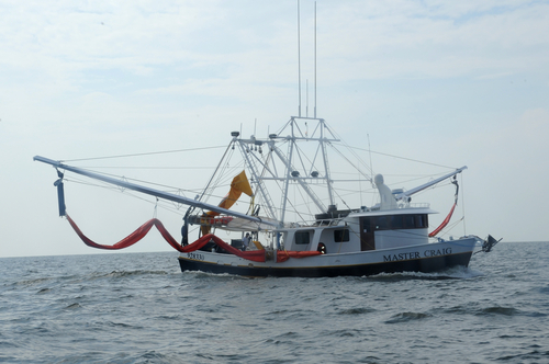A Shrimp Boat Rigged Up To Skim Oil