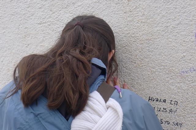 Pilgrim in prayer at the big Cross
