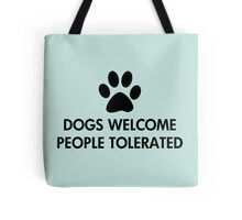 Dogs Welcome People Tolerated Tote Bag. Dog lovers saying / quote. With a black paw print.