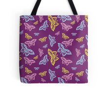 Colorful Butterfly PatternTote Bags. Butterflies in bright yellow, pink, and blue on a dark deep purple background.