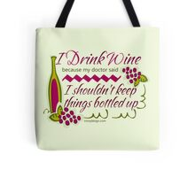 I Drink Wine Tote Bag. I Drink Wine Because My Doctor Says I Shouldn't Keep Things Bottled Up. Funny Wine Quote for Wine Lovers and Wine Drinkers. With a bottle of red wine with green wine vines and purple grapes graphic design.