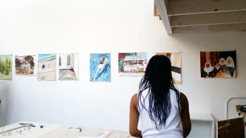 Critique day: Students had to find a photograph to paint of a space that used to be familiar, but has changed for them