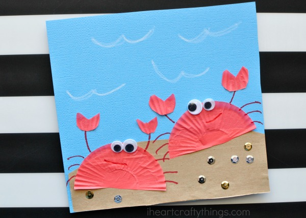 Select 2 different shades of orange colored craft papers for the crab papercraft. Cupcake Liner Crab Craft For Kids I Heart Crafty Things