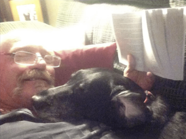 Man and Dog Reading
