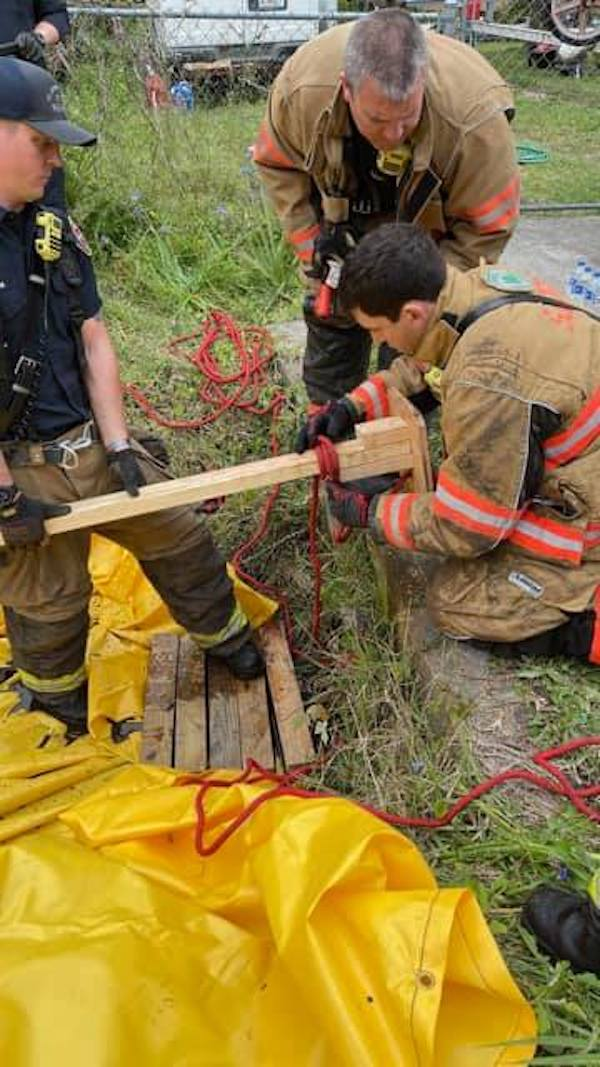 Firefighters preparing to rescue dog