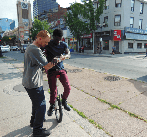 Twig helping Francis on the unicycle