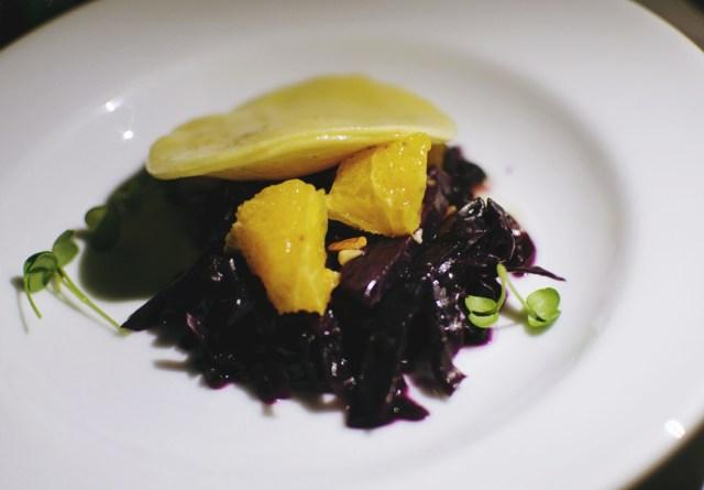 1st Course: Sweet Potatio Ravioli, red cabbage, grilled orange and hazelnut brown butter, radish. Photo by Lisa Vuyk