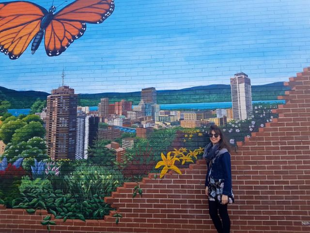 Kristin with mural by Tim Nijenhuis (Ninehouse Productions)