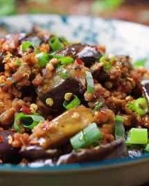 Paleo Asian Taco Meal Prep Bowls. Chinese-inspired eggplant meat sauce with tons of fresh veggies. Perfect Paleo and Whole30 meal prep dish!