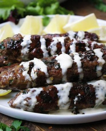 Delicious Paleo lamb kebab skewers recipe with fresh herbs in dairy free Tzatziki inspired tahini dressing.