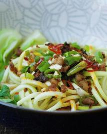 Easy and low carb Paleo Dan Dan Zucchini Noodles recipe with crispy crumble pork and bok choy vegetable in creamy sesame noodle dressing.