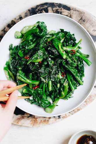 Easy Chinese Broccoli stir fry (kai lan) with garlicky sauce is a Vegan, Paleo, Whole30, Keto, and low carb recipe.