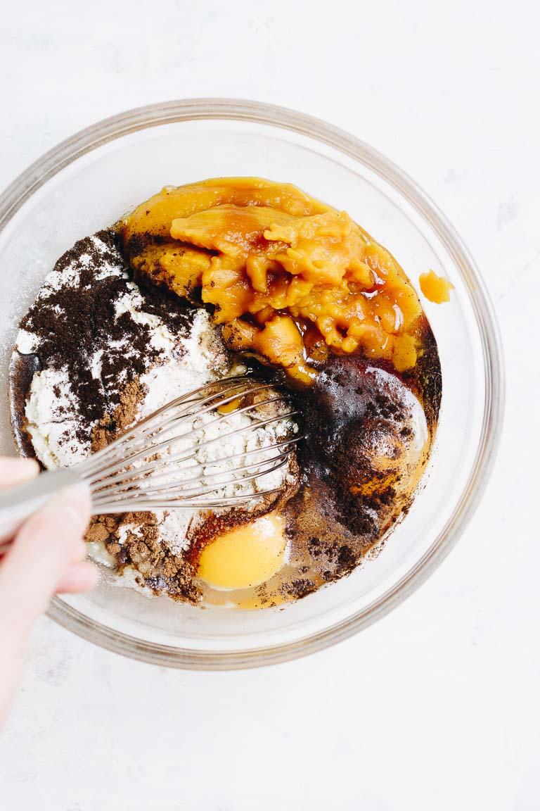 Paleo Pumpkin Protein Muffins Recipe with dark chocolate and coconut yogurt frosting.