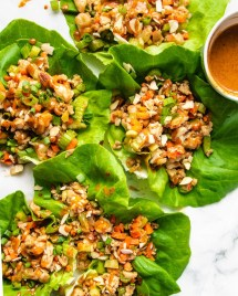Photo displays lettuce wraps over a white canvas plate