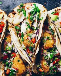 Paleo fish tacos recipe with gluten-free tortillas and tempura fish fillets and salsa sauce.