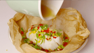 Pour hot oil over Chinese ginger cod fish