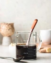 Keto Teriyaki Sauce in a glass measuring cup