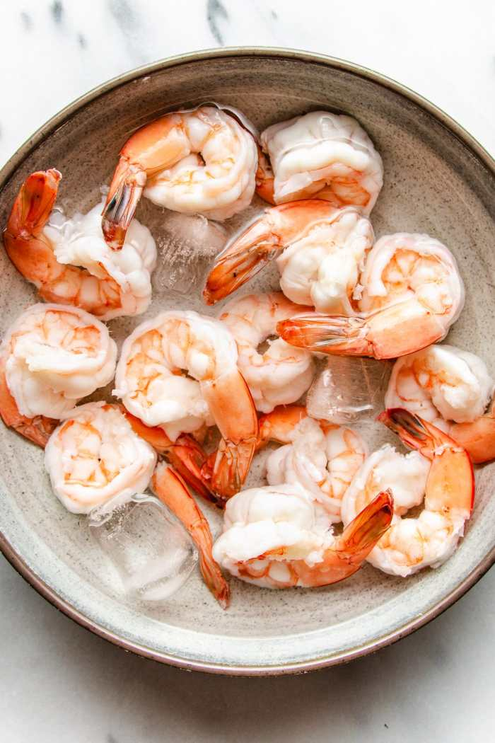 A photo of poached shrimp in ice water