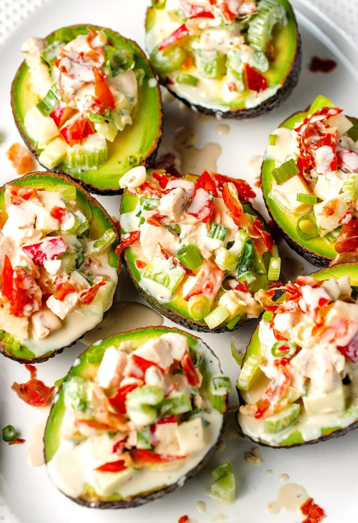 Stuffed avocados with chicken and apples over a large plate