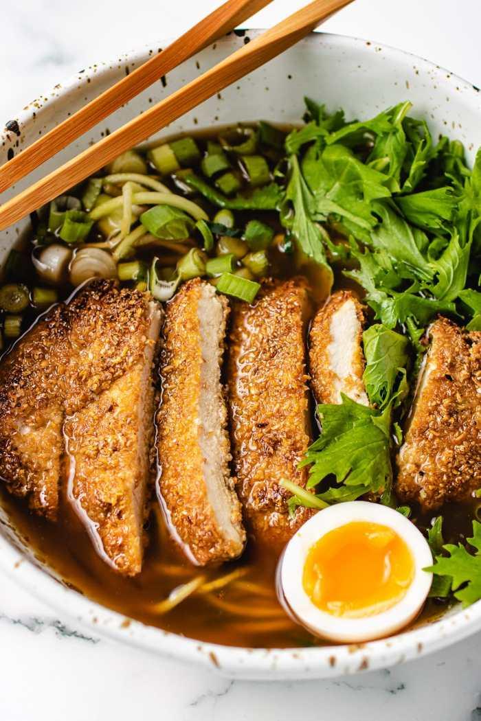 A close shot of ramen bowl with chicken katsu