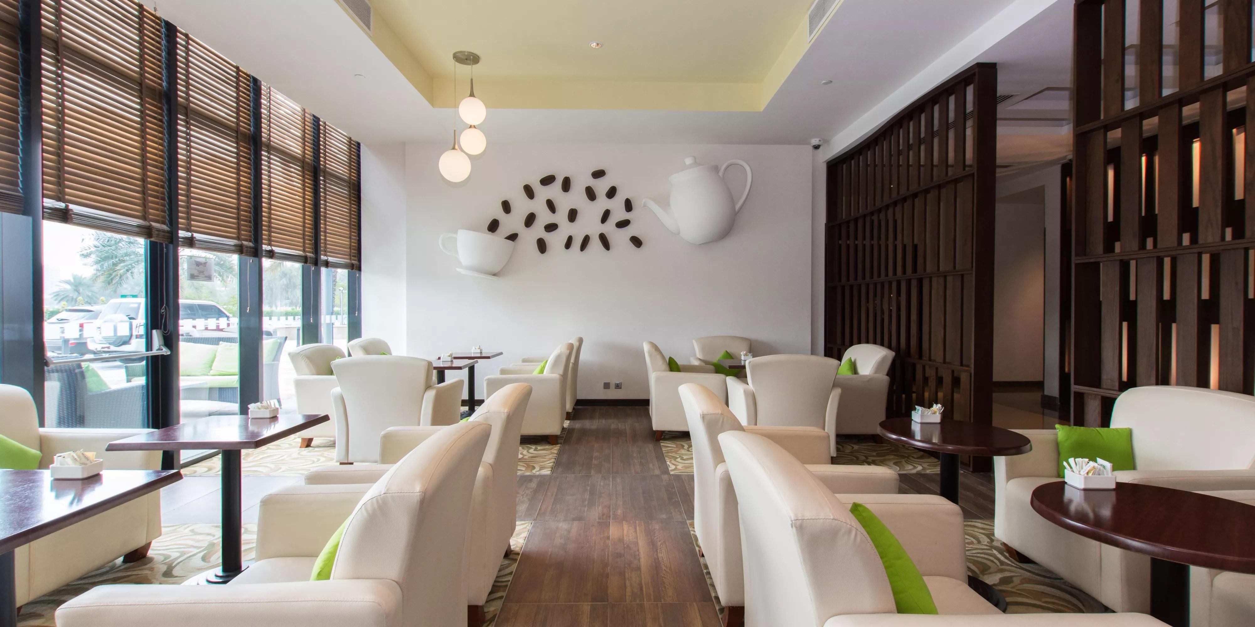 living room restaurant abu dhabi best sectional sofa for small restaurants near holiday inn