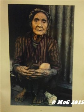a Filipino old lady with tattoos
