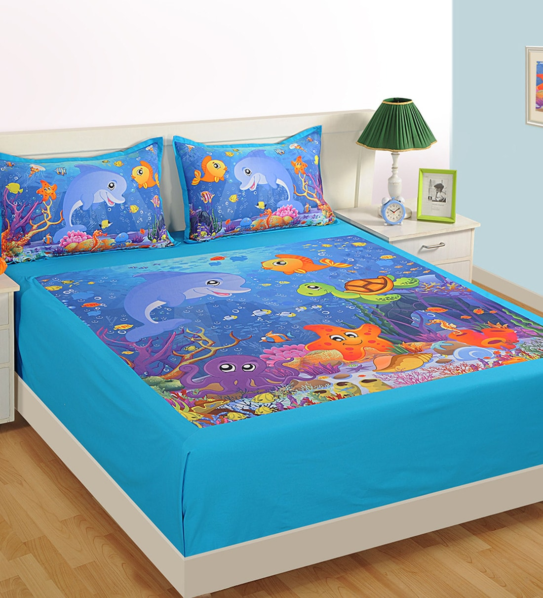 aqua themed double bed sheet with 2 pillow covers in blue colour