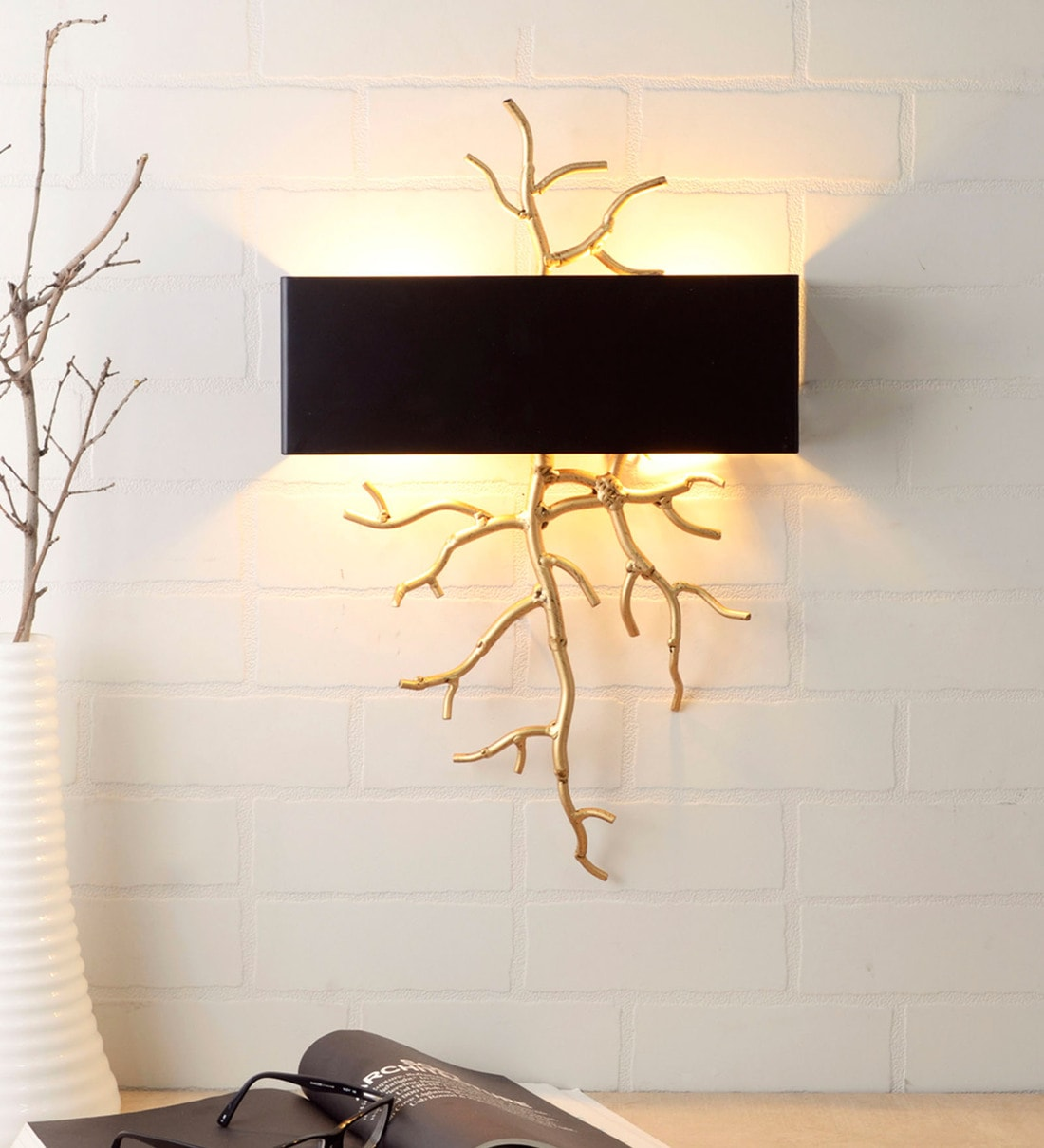 black and gold metal twig wall light