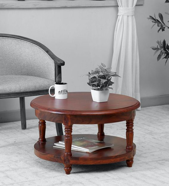 louis solid wood round coffee table in honey oak finish