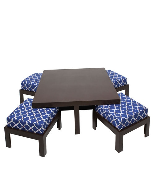 trendy coffee table with 4 stools in indigo colour by arra