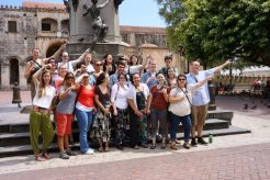 US students from Western Washington University Fairhaven College stand in front of the Columbus statue in the old town of Santo Domingo