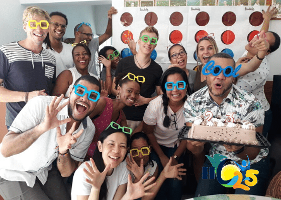 The IIC team and students learning Spanish at IIC Spanish School in Santo Domingo, Dominican Republic, celebrate the birthday of Director Jonathan Soto with a big cake and funny googles.
