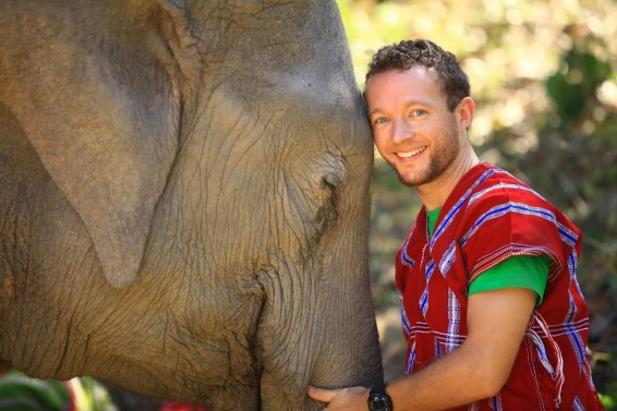 b Click A Tree founder Chris Kaiser and his beloved elephants