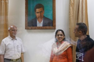 Prof Ganesh, Prof Raghuram and Prof Ambika with new portrait of S. Ramanujan