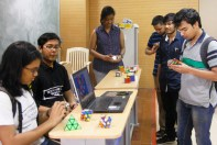 People trying their hand at Rubik's cube