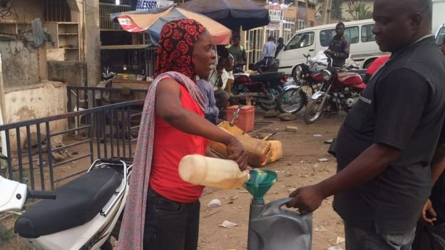 A woman selling petrol on the black market