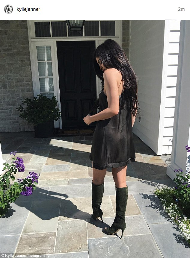Fancy: That same day she shared a photo where she was wearing a black sleeveless dress and black heeled boots while outside her new mansion